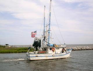 Shrimp boat leaving dock at Ocean Springs, Mississippi
