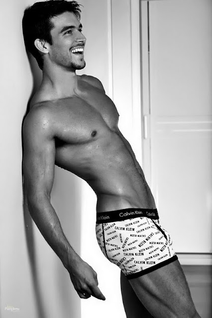 a smiling Bernardo Velasco looking incredibly sexy in his Calvin Klein underwear