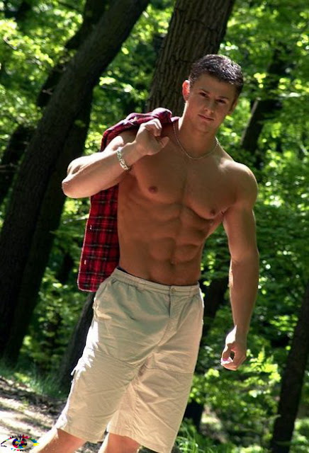 studly shirtless guy in the woods