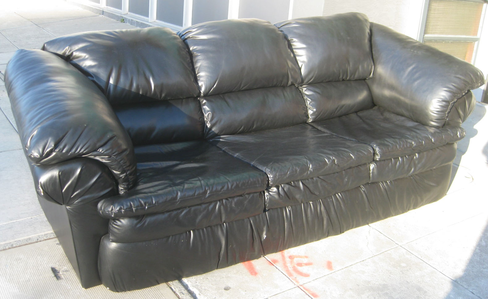 SOLD   Black Vinyl Sofa   $85