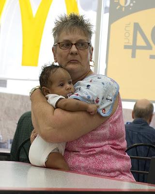 Resultat d'imatges de old white woman young black baby