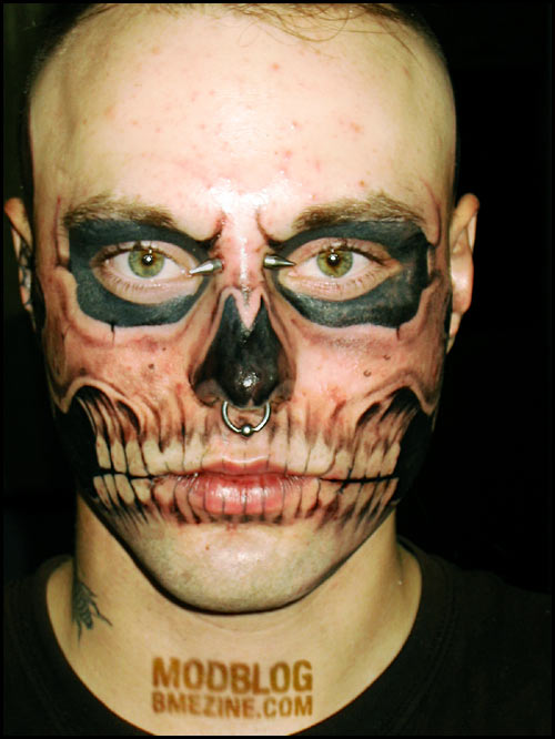 Men with Skull Tattoo Design on Face is a type of tattoo with a picture