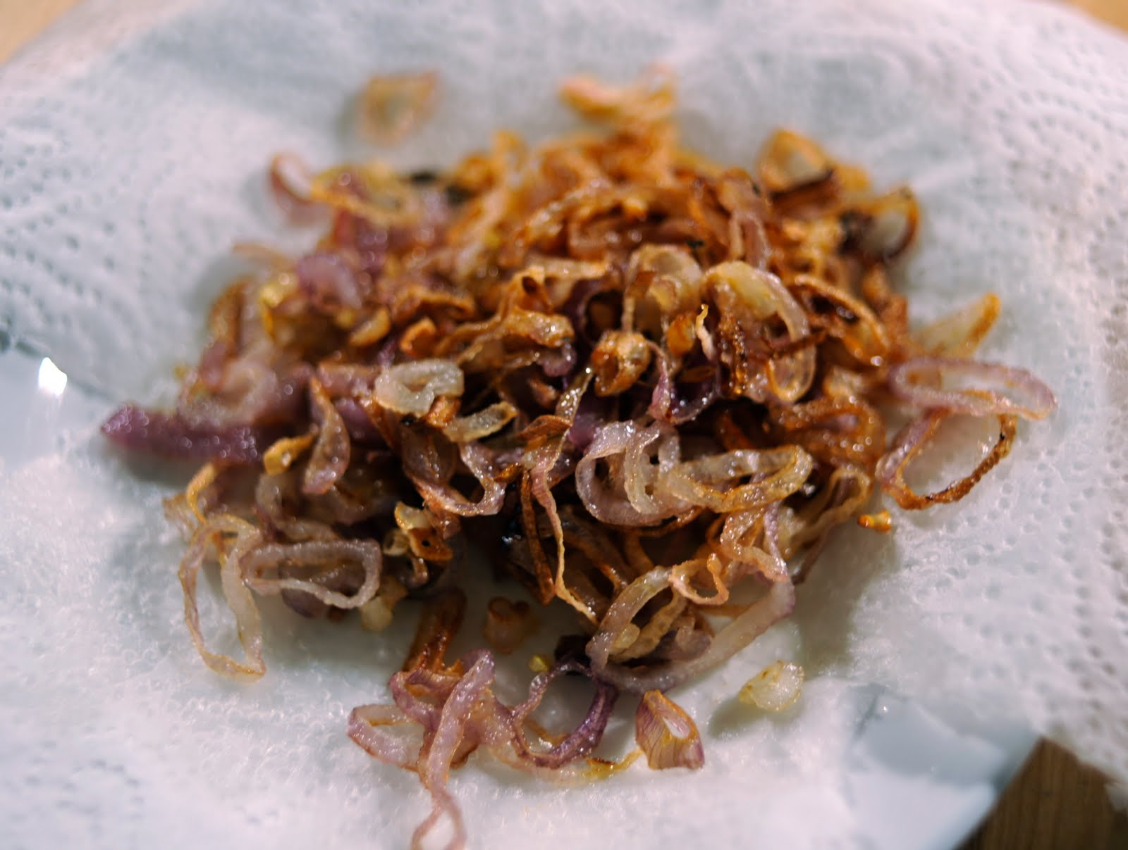 You start by deep-frying 3-4 large sliced shallots in one cup of ...