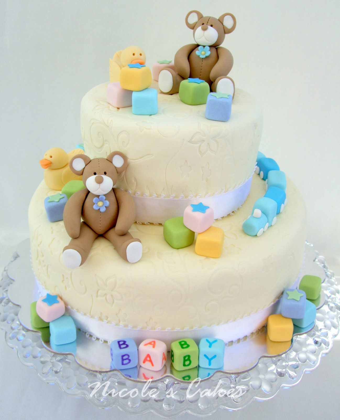theme for this shower cake was baby toys to welcome the new baby