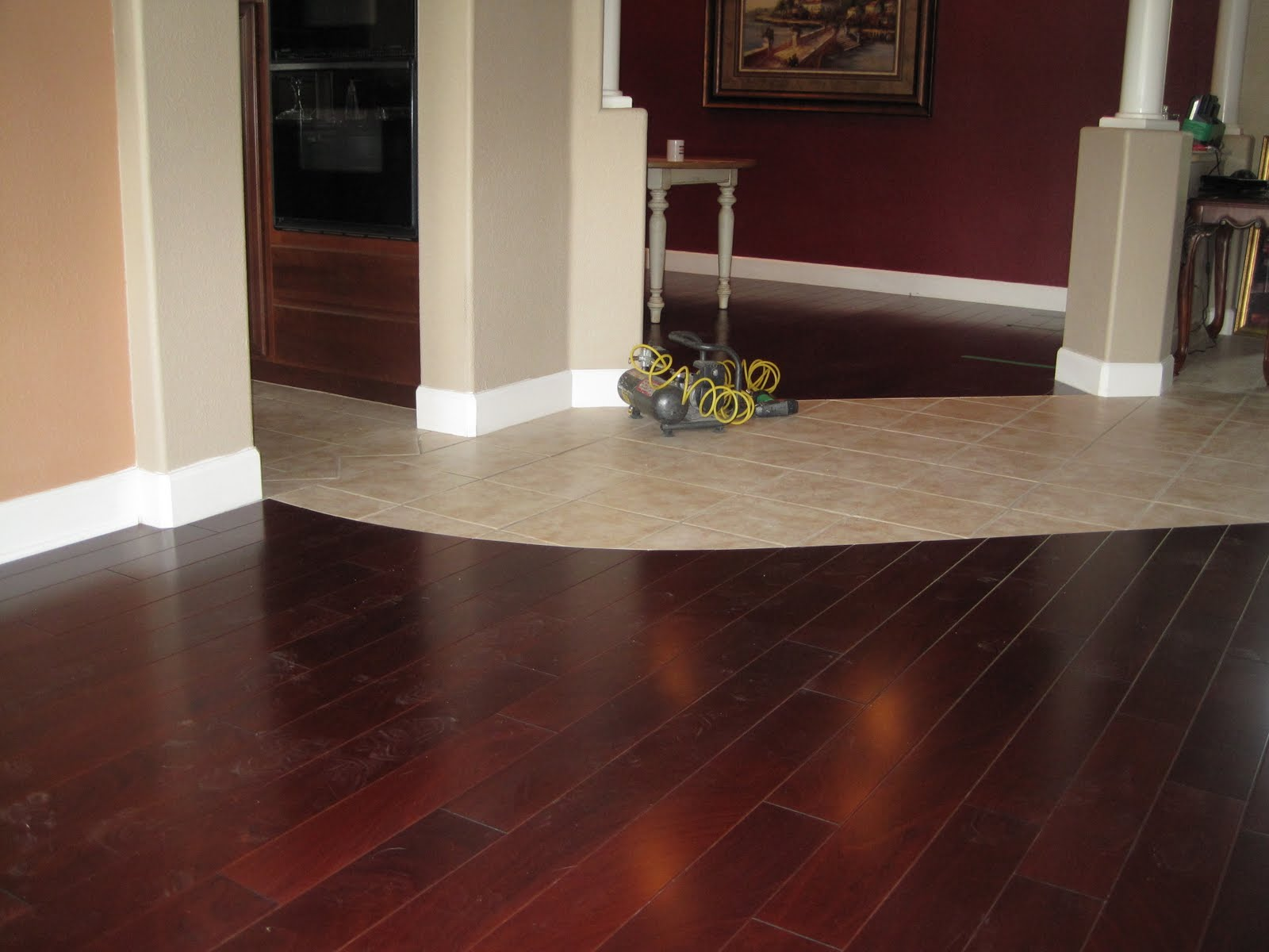 Sapele hardwood to replace carpet in the living room and dining room  title=
