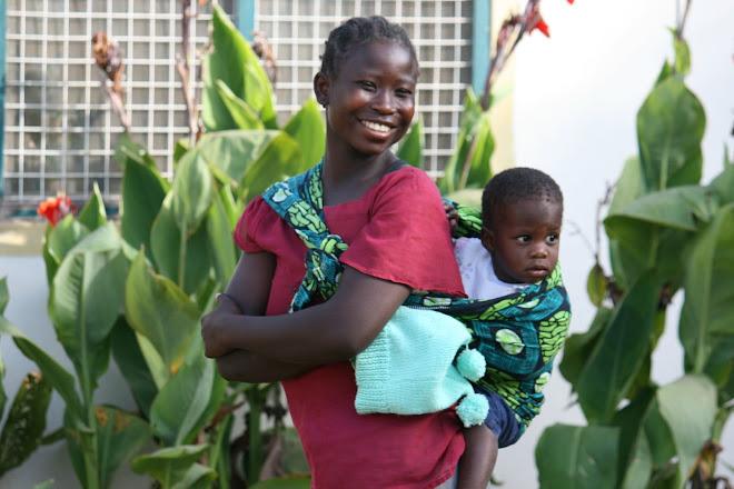 A caregiver and orphan at the Berega Orphanage