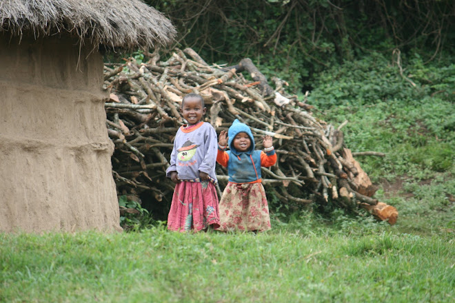 Two children outside a traditional homestead in Maasailand