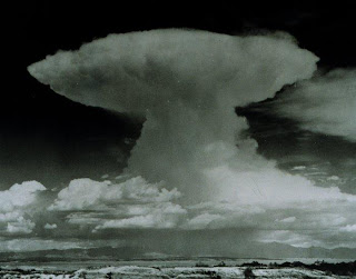 A mature cumulonimbus reaches the tropopause and, unable to rise higher, spreads into the characteristic anvil.
