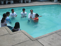 Happy believers in Christ - during a water baptism