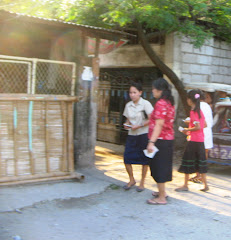 Sis. Chona, my wife and my daughter Angelove (red shirts) in a house-to-house Gospel Tracts Min.