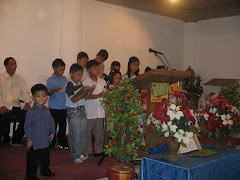 Angel O. Duenas II-my only son (with long sleeve)-standing in front while other kids are singing.