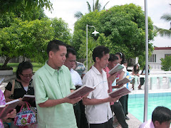 Some brethren were singing while Baptism is going on.