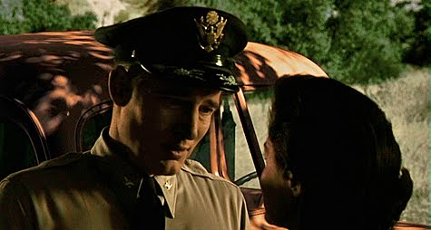 Col. Robert Calder (William Hopper) and Marisa Leonardo (Joan Taylor)