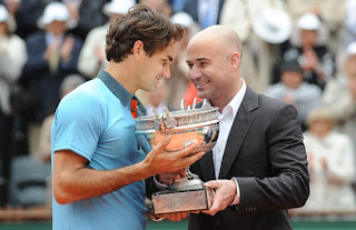 Federer getting then French Open Trophy from Agassi...