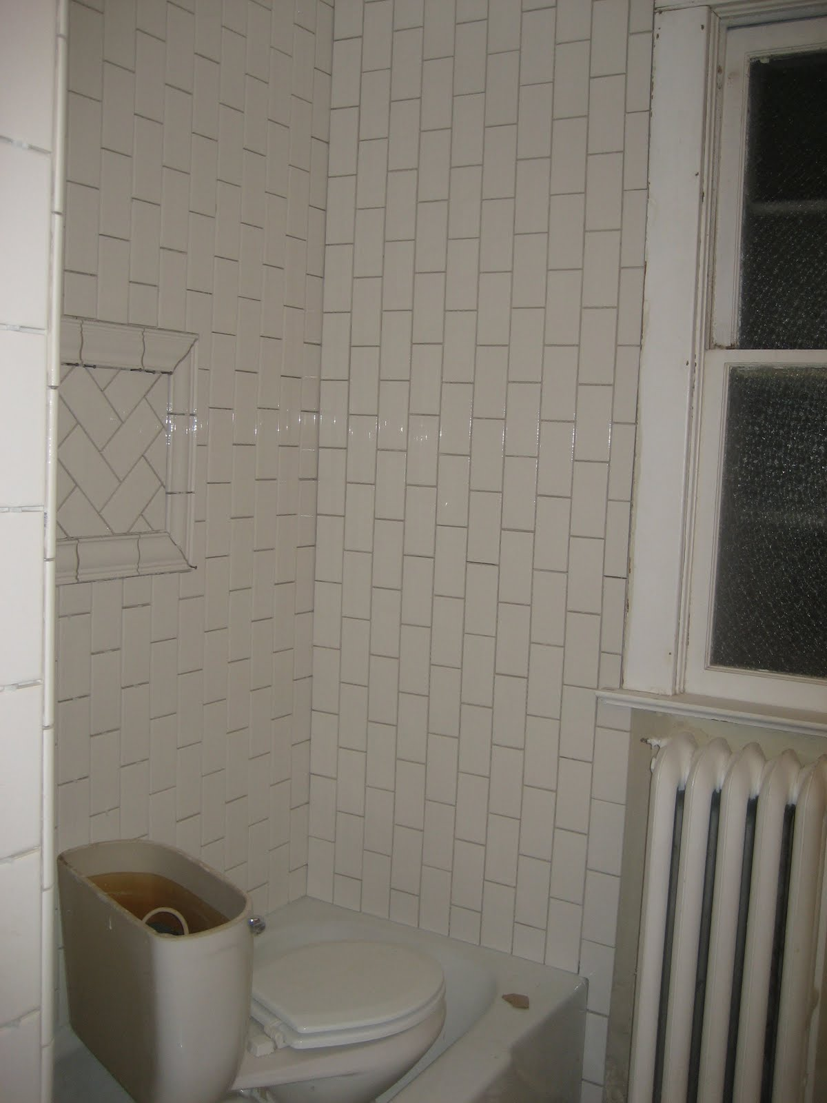 We ran the tile vertically in a running bond pattern Bathroom tile showers