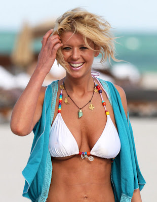 Tara Reid on beach with a football