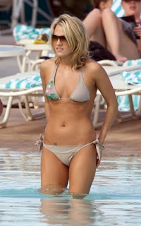 Carrie Underwood caught in tiny bikini