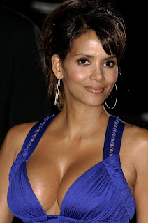 Halle Berry flaunts her assets