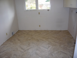 Sausman floor coverings seattle subfloor preparation vct for Preparing floor for vinyl