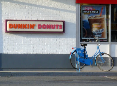 blue bike at Dunkin Donuts