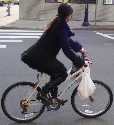all black outfit on a bike