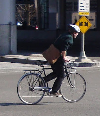 man on city bike