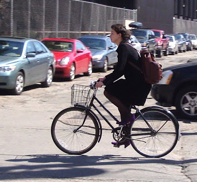 girl on a three speed with purple suede heels