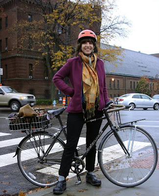 autumn cyclist purple orange gold Boston rain