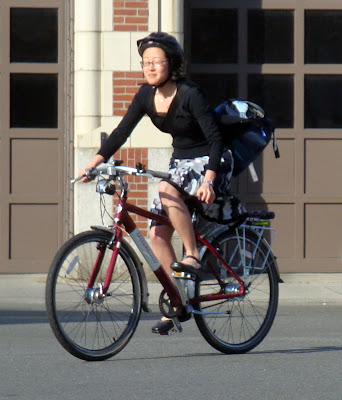 girl in a skirt riding her bike in Boston