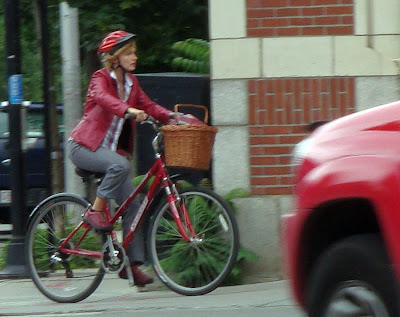 lady cyclist in red
