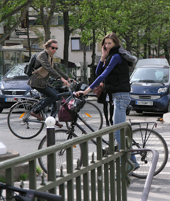 Pair of Parisian chic cyclists