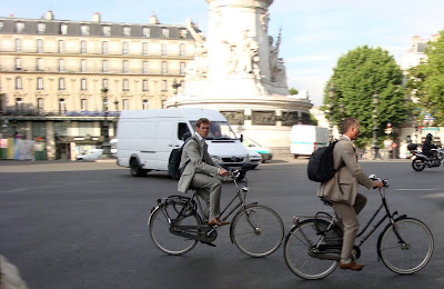 Parisians in suits on bicycles