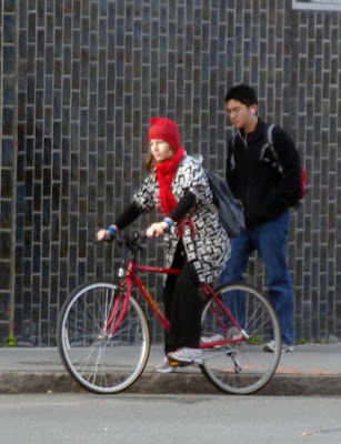 black and white jacket red bike