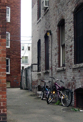 cheap bikes in an alley