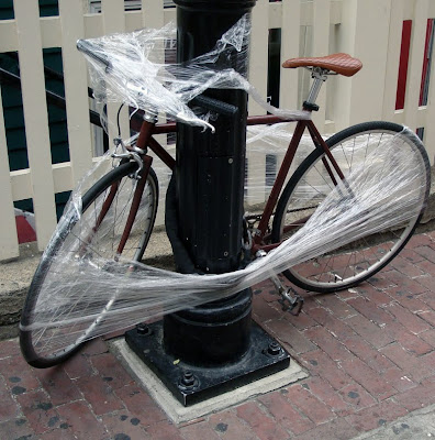 bicycle wrapped in plastic wrap