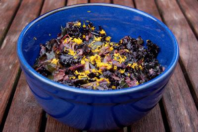 Bowl of wilted kale salad with balsamic vinegar and orange zest
