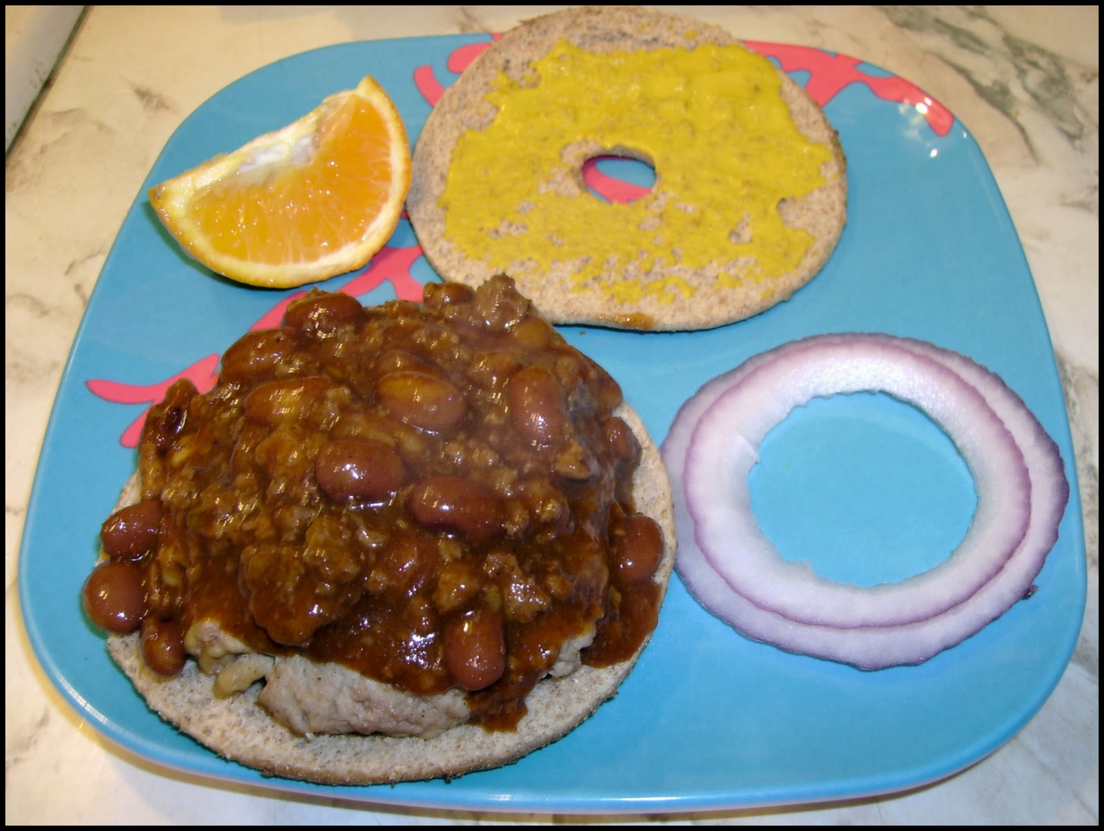 Place the bun (bagel) bottom on a serving plate. Add the burger ...