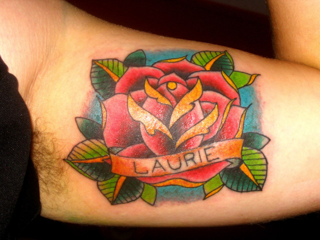 rose tattoos. rose tattoos on side. lower