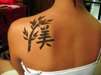 tattoo on back girl. girl cross tattoos. lack