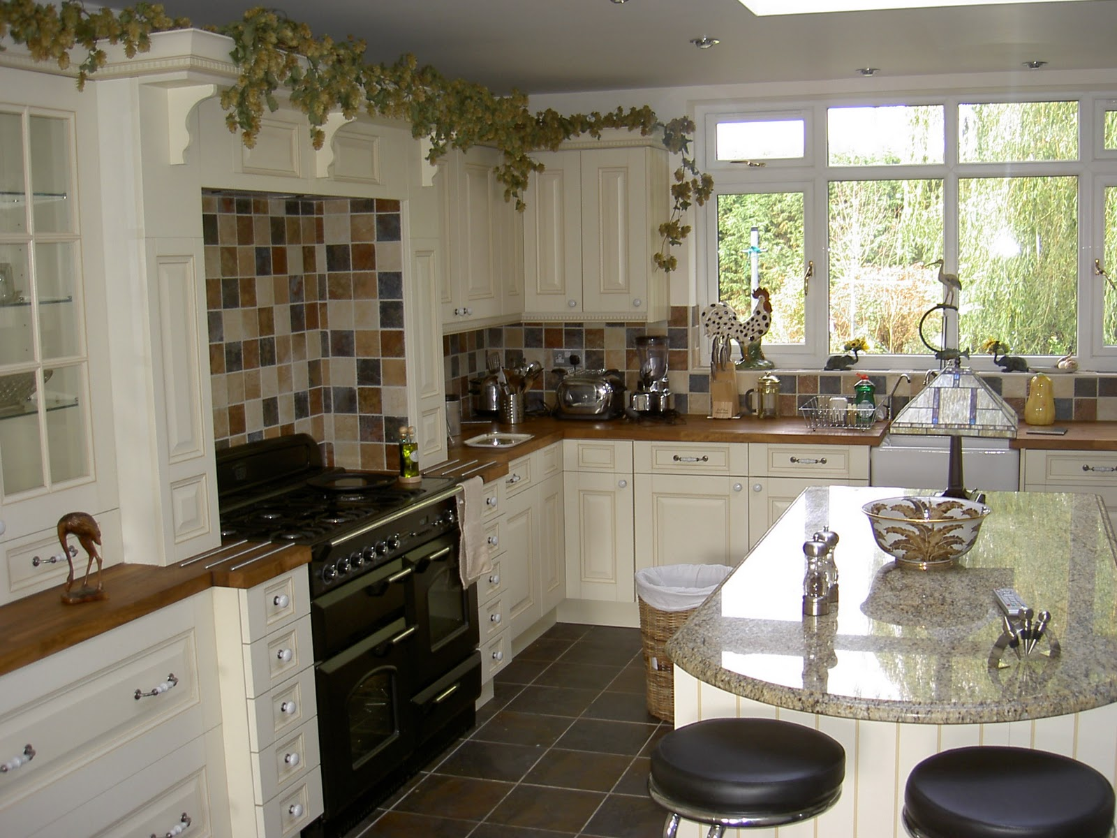 Country cottage living moodboard finishing touch interiors for Pictures of country kitchens