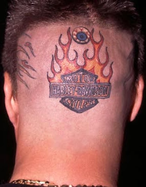 Photo of a man with a Harley Davidson Tatto on the back of his head