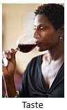 Photo of a woman drinking a glass of wine.