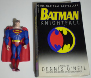 Superman action figure and Batman: Knightfall paperback book
