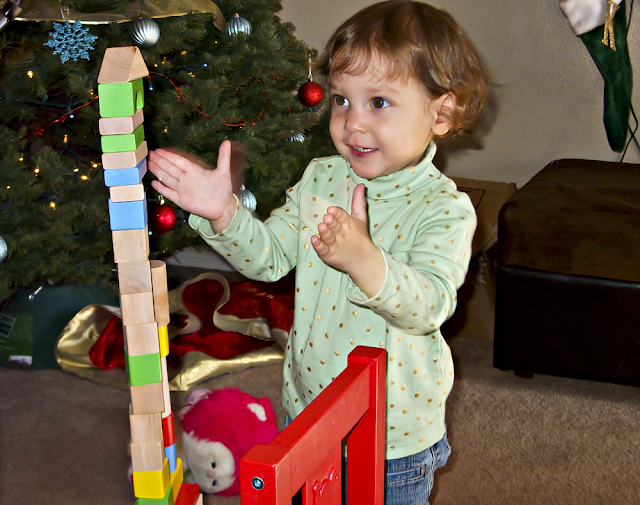 Afton clapping after finishing building her tower