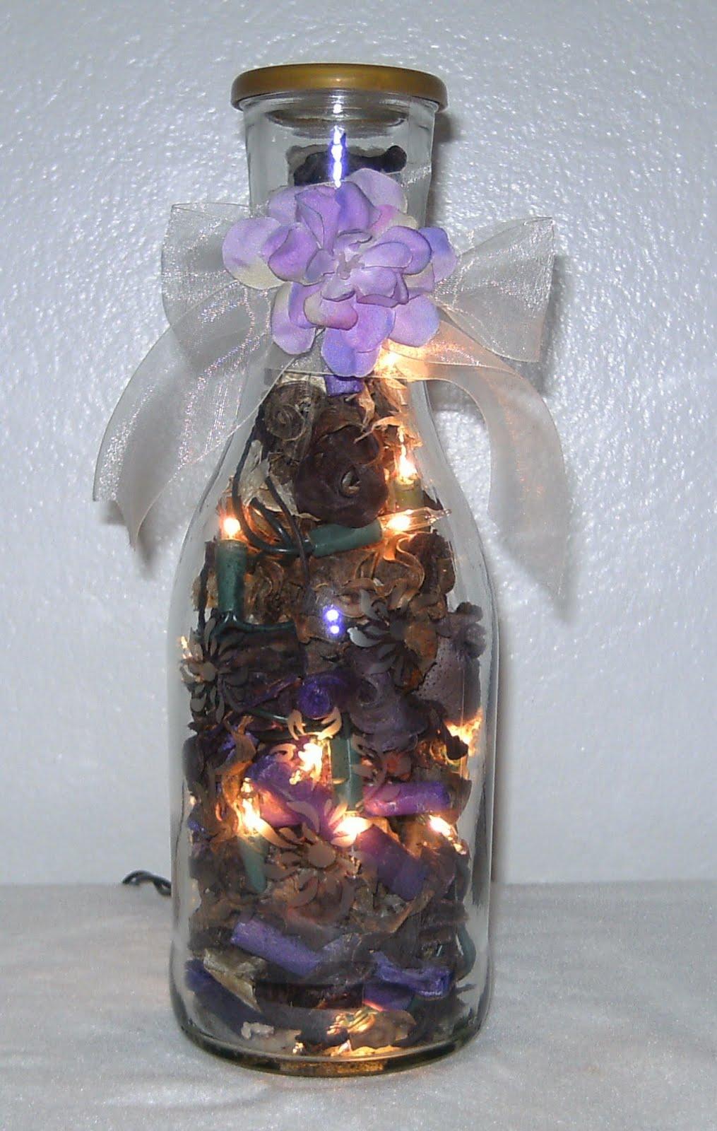 Elegant wine bottles lighted wine bottle with popuri for Light up wine bottles