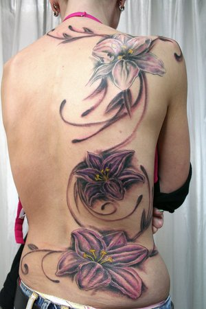 flower tattoo pics. Flower tattoos body search