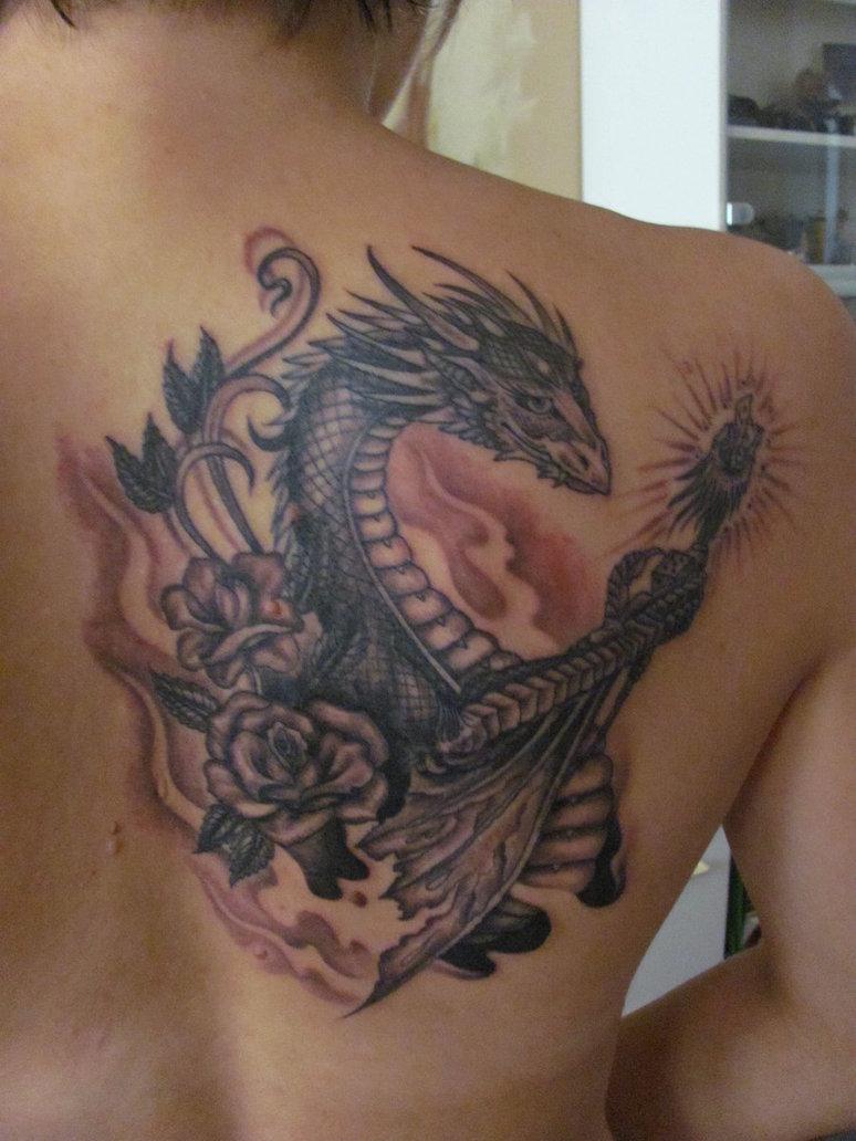 Guys back a tattoo lion Dragon
