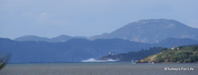 Waves Crash Against Red Island in Fethiye