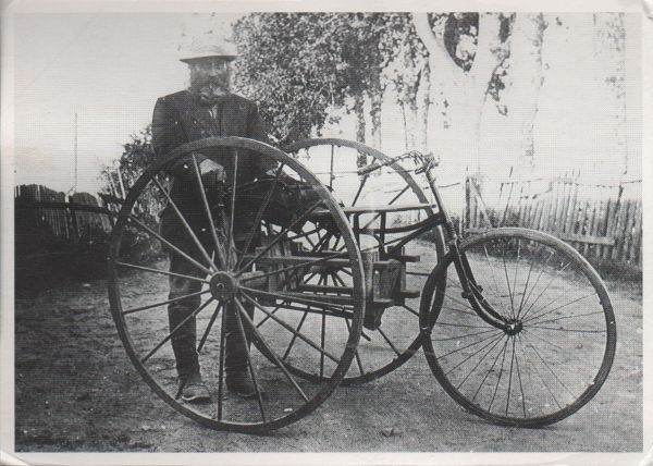 postcard showing a postman in Finland with a large tricycle