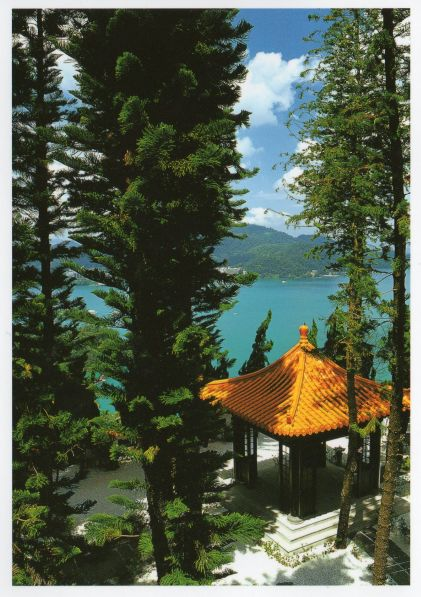 postcard view of Sun Moon Lake Taiwan, through trees